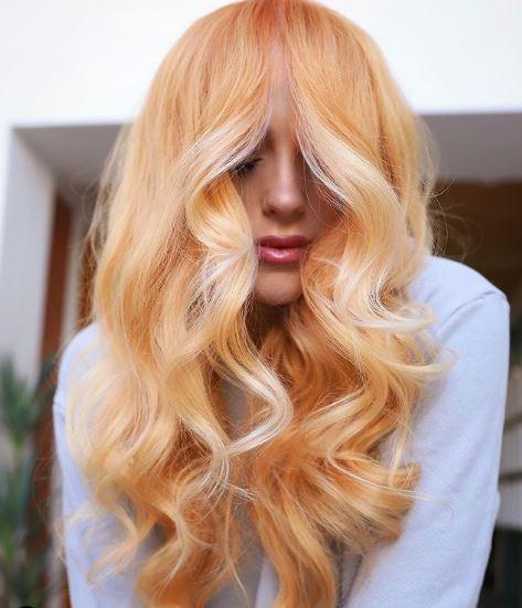 Vörös hajszínen gondolkodsz? Őszibarack és krémhaj most a legszebb tónusok